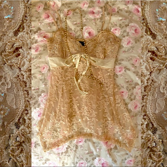 Beautifully detailed cream camisole by Express